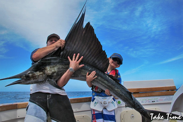 Geoff Harris helps young PJ Bennett hold up his sail for a quick photo before release.
